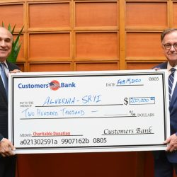 Alvernia University President John R. Loyack, left, receives a check for $200,000 from Customers Bank President and CEO Richard Ehst.